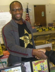 ECBACC VP Akin Brown shakes hands with a child, http://ecbacc.com/wordpress3/2010/ecbacc-at-kids-comic-con-2010/