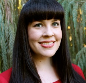 Mara Zehler - Caitlin Doughty, CC BY-SA 4.0, File:Caitlin Doughty in red evergreen background.jpg Uploaded by Materialscientist Created: January 1, 2014