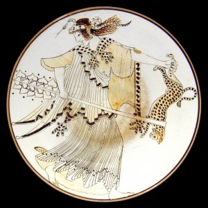 Furious Maenad, carrying a thyrsus and a leopard, with a snake rolled up over her head. Tondo of an Ancient Greek Attic white-ground kylix 490–480 BC from Vulci.