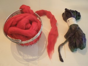 Wool roving balled and ready to knit, next to the extra skein of yarn for the COWYAK.