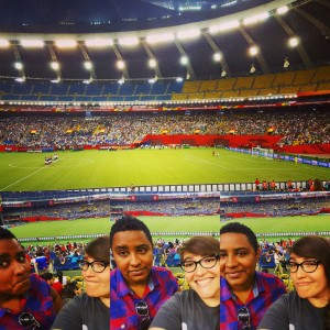 Two women in a selfie in front of the field at Olympic Stadium, Montreal.