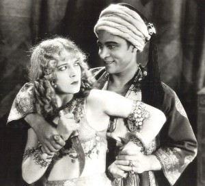Enthusiastic concent...? Agnes Ayres and Rudolph Valentino in the 1921 film of The Sheik.
