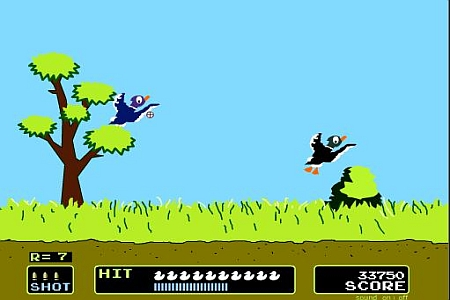 Duck Hunt, Nintendo, 1984. Two cartoon ducks fly away from green grass and a tree.