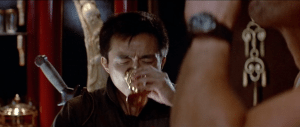 Wang Chi taking a shot of Chinese potion, while giving a patriotic American toast.