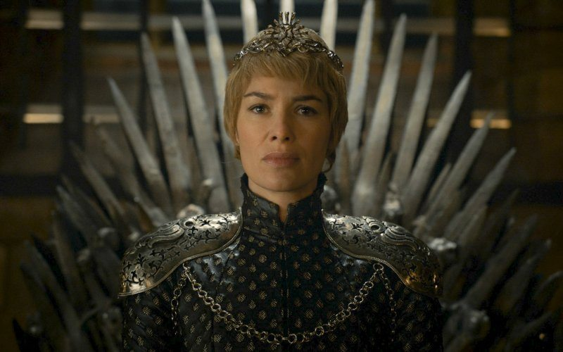 Cersei Lannister on the Iron Throne after being crowned queen. Note the lack of Baratheon trappings.