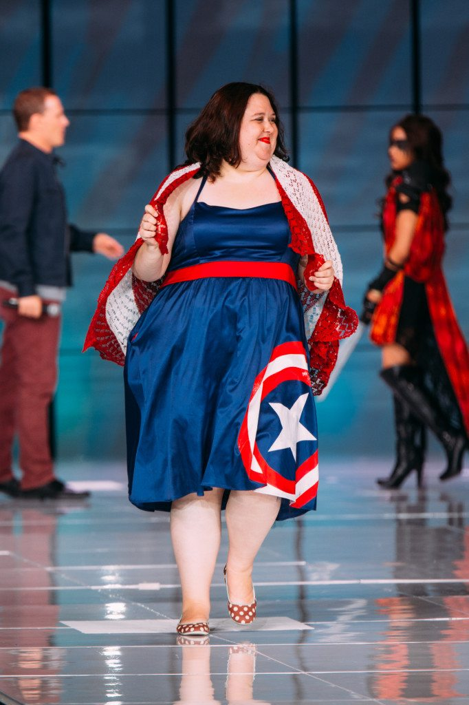 The author wearing the Her Universe Captain America dress from Torrid, and a hand-knit Captain America shield.