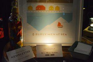 Burly Men at Sea Booth