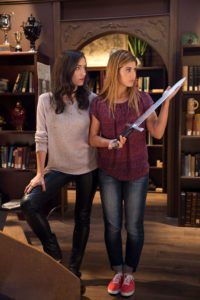 Carmilla and Laura pose with a sword