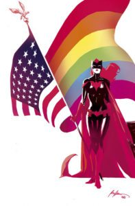 Batwoman pin-up from Love is Love, showing Batwoman holding an American flag whose back side is the rainbow Pride flag. Art by Rafael Albuquerque. DC/IDW.