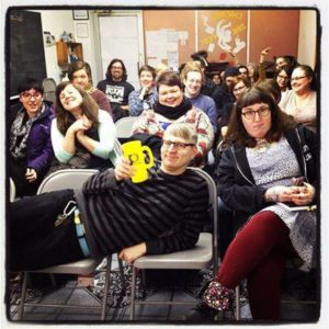 "Zinesters and guests pose at ""Witches, Bellies and Writers Traveling Road Show,"" a 2014 book tour that stopped at the center. Image courtesy CHIPRC."