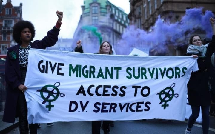 Women protest for domestic violence resources to be made available to immigrants, in London