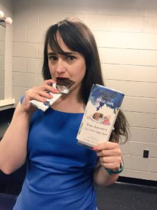 """Matilda"" actress and author Mara Wilson eating Rococo's ""Matilda""-themed chocolate bar, a gift from the Dahl family"