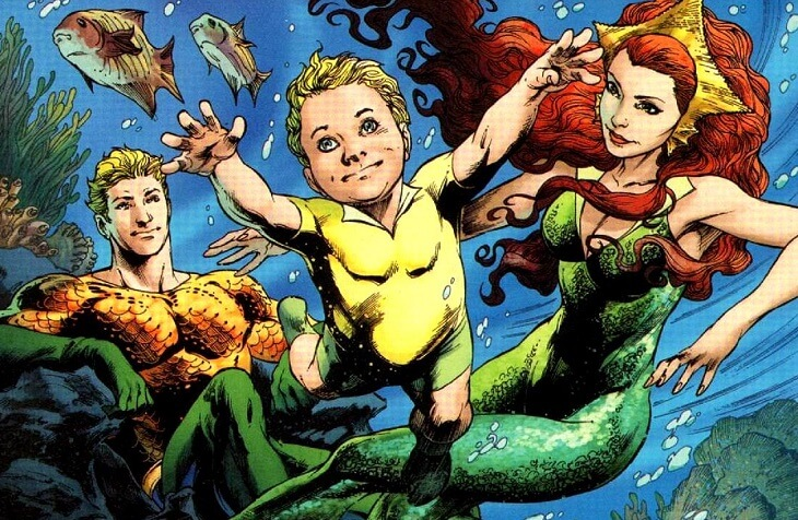 Aquaman, Meera, and Aquababy are under water, Aquababy swimming toward us as Arthur Curry sits and watches happily. From Brightest Day #16, DC Comics.