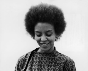 Headshot in black and white of Poet Nikki Giovanni who wrote Where Do You Enter