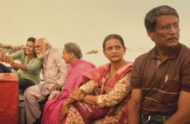Hotel Salvation still, with family members on a boat, some smiling, others sombre; Hotel Salvation (2017), Red Carpet Moving Pictures, directed by Shabhashish Bhutiani, starring Adil Hussain as Rajiv and Lalit Behl as Daya.