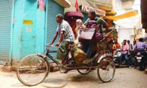 Daya (Lalit Behl) and Rajiv (Adil Hussain) take a rickshaw to Hotel Salvation