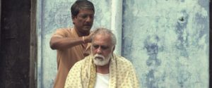 Rajiv (Adil Hussain) gives a head massage to his father (Lalit Behl)