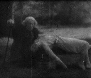 Marguerite Chopin kneels over Léone in Vampyr