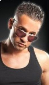 """Closeup photograph of Mike """"The Situation"""" Sorrentino, short brown hair spiked up on top, sunglasses slid down his nose, black tank top"""