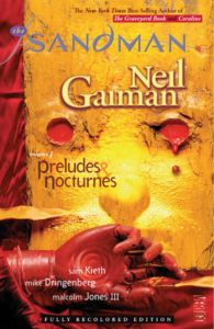 2010 cover of Preludes & Nocturnes, with a disembodied red marionette's hand lying before a gold wall with two circular holes filled with red that resemble eyes nad a shadow just above the hand that resembles a nose.