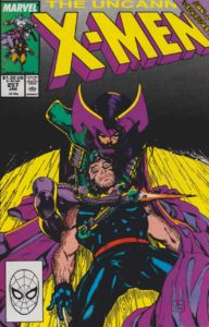Psylocke, as the evil Lady Mandarin, holds a comatose Wolverine
