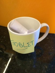 a mug with a post-it note saying GOBLET.