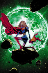 Supergirl kneeling somberly in front of an exploding Krypton