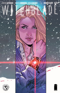 Cover of Witchblade #7 (Top Cow Productions, August 2018) - A blonde, determined woman holds up her wrist, which is covered by a dark metal bracer with a red gem shining in its center, against a snowy background