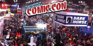 Picture of NYCC - A huge crowd of people on the convention floor with a Dark Horse banner in the foreground
