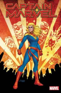 Captain Marvel stands tall, surrounded by images in fire of her at different times