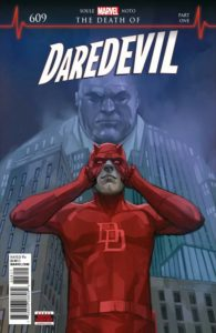 Daredevil pulls on his cowl, while Kingpin looms behind him.