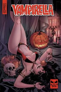 Vampirella being sexy among the Halloween decorations