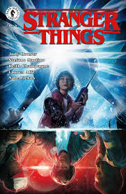 Cover Stranger Things #1 - Will holds a walky-talky and looks scared; behind him is the silhouette of the Demogorgon with a blue light erupting from its head reminiscent of the poster for John Carpenter's The Thing. On the flip side of this image Mike, Dustin, and Lucas look worried and a red light shines behind them