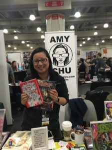 Amy Chu holds up two of her books