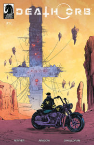 Death Orb #1 Cover: A figure on a parked motorcycle is seen from behind looking at a huge mechanical structure shaped like an upside-down cross; the setting is a barren orange-tinted desert with a few cliffs
