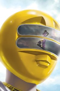 The Secret Ranger is seen on the Yellow Ranger's visor in the Mighty Morphin Power Rangers #33 Cover C. Written by Marguerite Bennett and drawn by Simone Di Meo. Published by BOOM! Studios. November 28, 2018