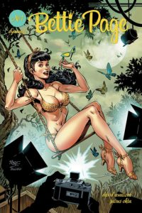 Bettie Page #1: The Princess and the Pinup David Avallone (writer), Kevin Ketner (editor), Julius Ohta (artist), Taylor Espositor (letterer), Ellie Wright (colourist) November 2018 - A pin-up portrait of Bettie in a leopard-print bikini on a swing while a camera takes her picture