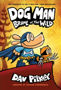 Dog Man: Brawl of the Wild cover; Dog Man and Cat Kid standing on the edge of a bluff, staring in the distance