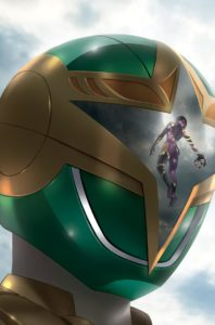The Pink Ranger is reflected in the visor of the Green Ranger in Mighty Morphin Power Rangers #34 Cover C. Written by Marguerite Bennett and drawn by Simone Di Meo. Published by BOOM! Studios. December 26, 2018