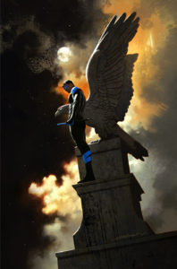 Nightwing standing in front of an Angel statue, appearing to have the angel's wings