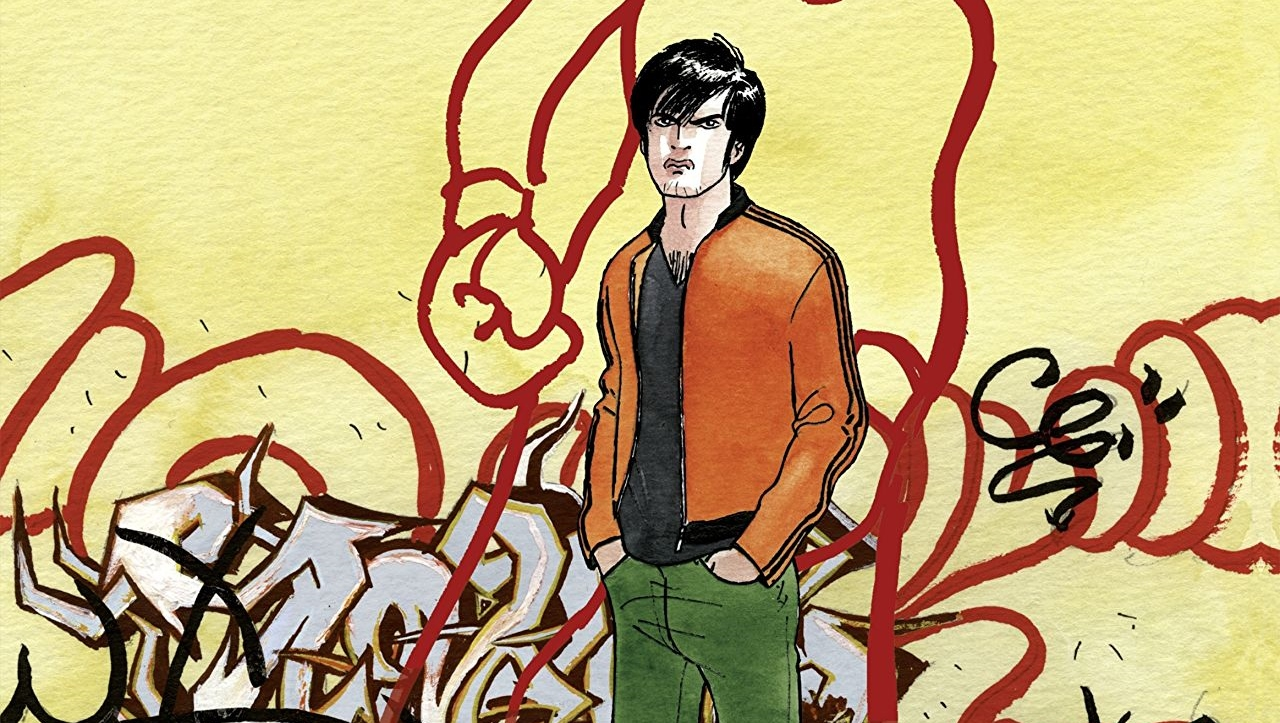An angry young man stands before a graffiti-ed wall in Rage volume 1. Written and drawn by Baru. Published by Europe Comics. November 21, 2018.