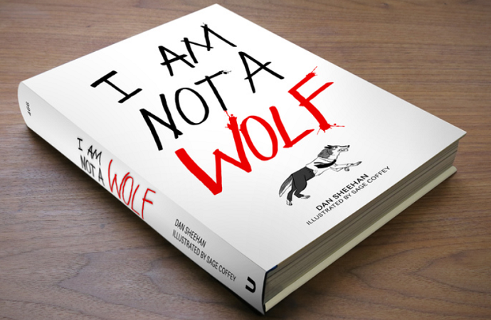 "White book with title ""I AM NOT A WOLF"" and a drawing of a running wolf, sitting on a brown wooden table"