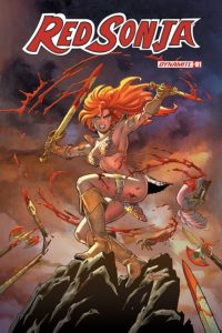 Red Sonja volume 5 (Dynamite Entertainment, February 2019) - Sonja poses in mid-air while slashing through enemies with sword and knife, baring her teeth ferociously