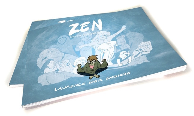 Two mockup copies of Zen & The Ephemeral, piled on top of each other. The cover is a swirling mass of blue on first glance, eventually solidifying into the main character, a white person dressed in a baggy green cardigan and dark blue pants, sitting cross legged in the bottom center. They are surrounded by people drawn in shades of blue, emoting grandly. Zen & The Ephemeral, Laurence Dea Dionne, 2019.