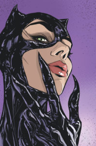 Close up of Catwoman's face with her claws to her lips