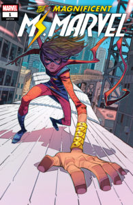 Cover for Magnificent Ms. Marvel #1 - Kamala Khan in the Ms. Marven outfit runs atop a subway train, using her super-enlarged hand to hold on