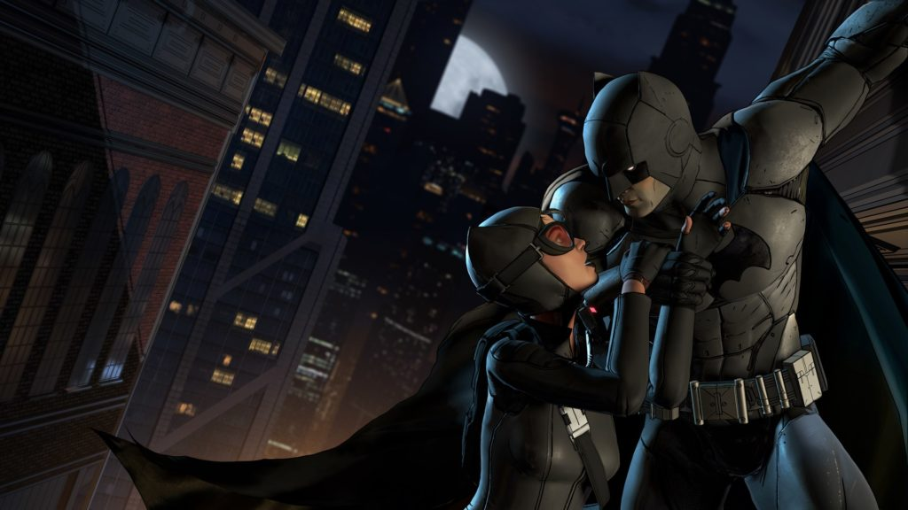 Batman and Catwoman hanging from building