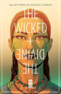 Cover of The Wicked + The Divine - Portrait of a gender-ambiguous face with dark shoulder-length hair, red eyes, and green makeup resembling vines covering their cheeks, temples, and neck