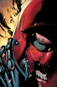 Close up of Red Hood's face with a broken mask