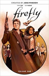 An armed man and woman are ready for a fight on the cover of Firefly: The Unification War Part One